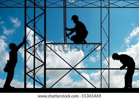 workers on site with sky in background - stock photo
