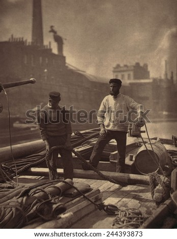 WORKERS ON THE SILENT HIGHWAY 1877 by John J. Thomson 1837-1921 shows two workmen on a barge on the Thames River England. Thomson was one of first social documentary photographers. - stock photo