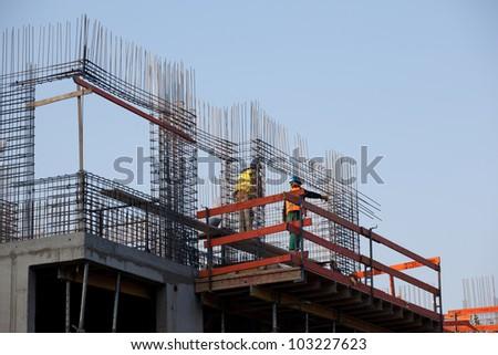 Workers preparing concrete reinforcemente - stock photo