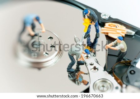 Workers repairing hard drive. Macro photo - stock photo