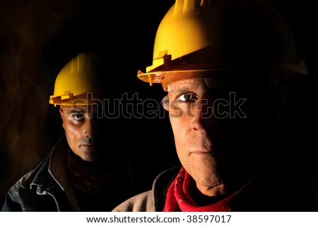 Workers team  isolated in black - stock photo