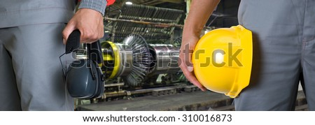Workers with safety uniform at industrial factory - stock photo