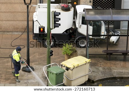 workers with street sweepers  electrical  vehicles cleaning the city - stock photo