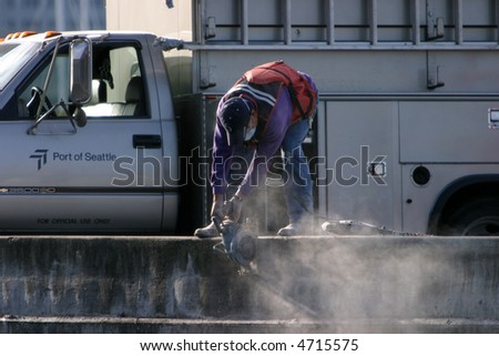 workers work on the docks in seattles Puget Sound area - stock photo