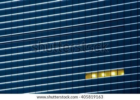 Workers working late.Office buildings in the night/Office buildings in the night - stock photo
