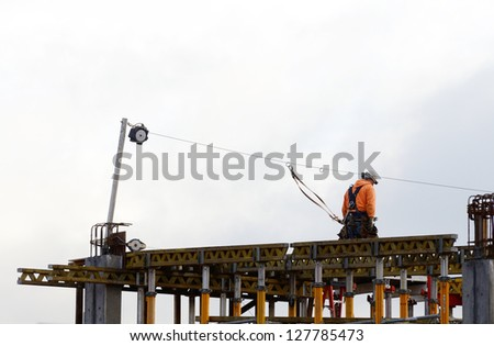 Workers working on a new parking garage in Portland Oregon - stock photo