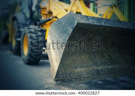Working backho heavy industrial truck on street - stock photo