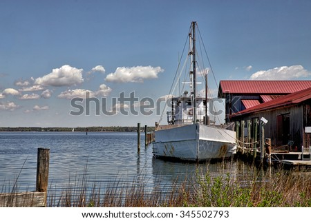 Working boat on a beautiful Spring day at the Chesapeake Bay Maritime Museum in St Michael's, Maryland. - stock photo