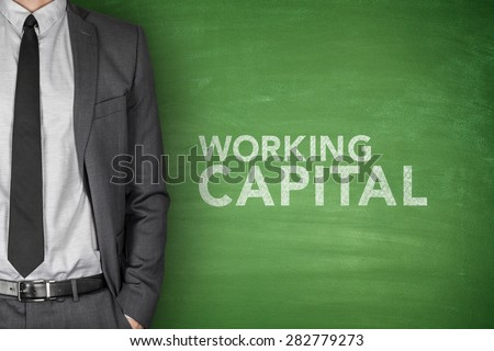 Working capital on green blackboard with businessman - stock photo