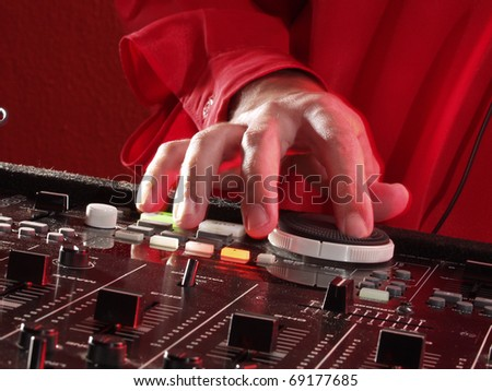 Working Disc jockey at party. Detail of a disc jockey  hands. - stock photo