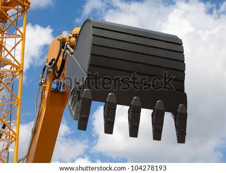 Working excavator shovel - stock photo