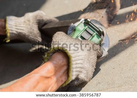 Working hand-held grinding steel - stock photo