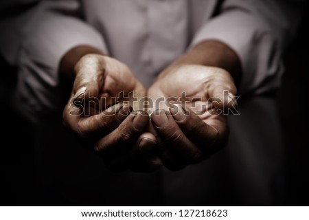 working hands of old man - stock photo