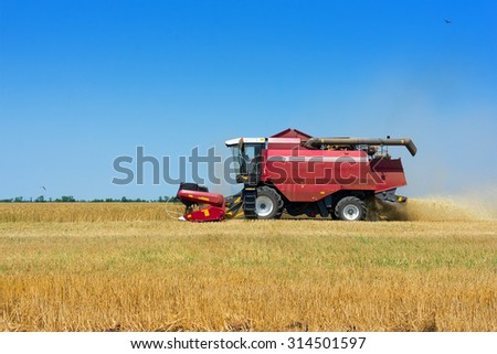 Working harvester - stock photo