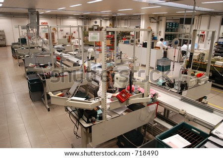 working in a factory - stock photo