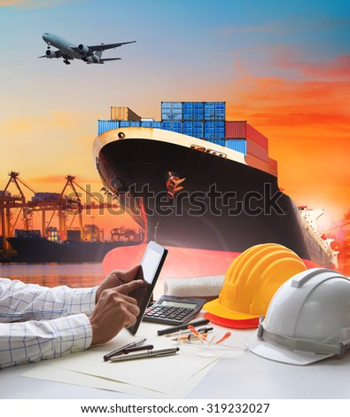 working man and container ship for logistic and transport business - stock photo