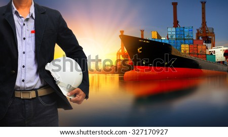 working man and container ship in import,export logistic business - stock photo