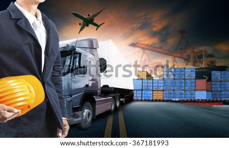 working man and truck loading container in port cargo plane flying for import export logistic business - stock photo