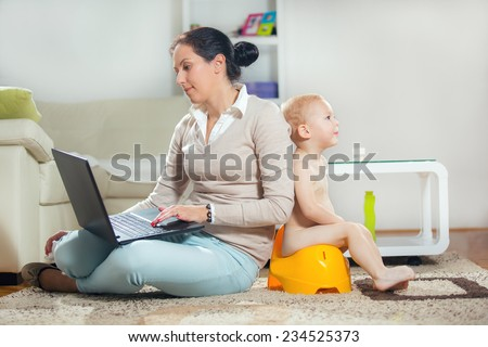 Working mother working at home and not watching his child to the potty - stock photo
