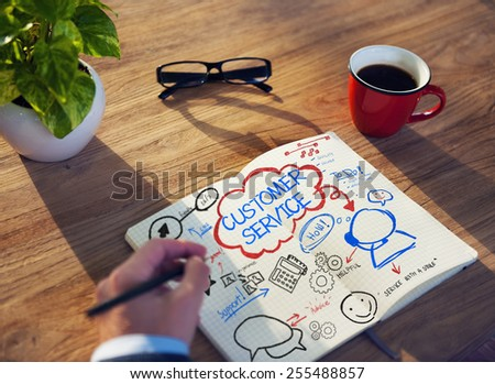 Working Notepad Customer Service Satisfaction Concept - stock photo