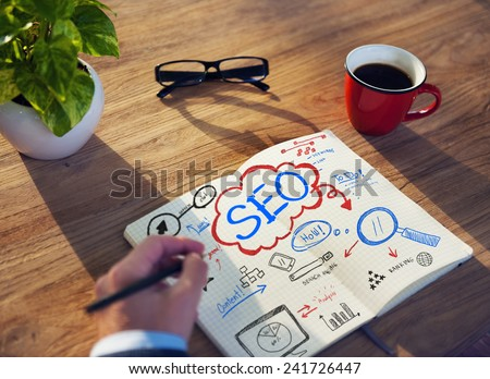 Working Notepad SEO Searh Engine Optimization Searching Concept - stock photo