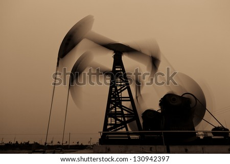 Working oil pump jacks - stock photo