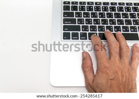 working on laptop, hands typing - stock photo