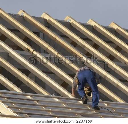 Working on new roof - stock photo