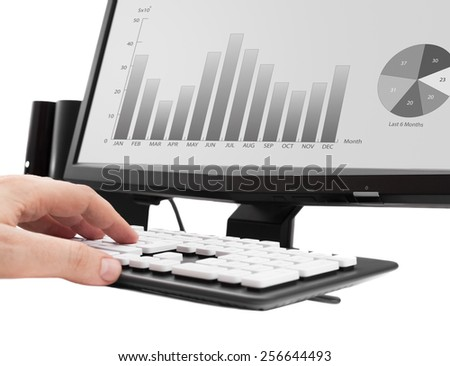 working on office computer. Income analysis graphics on computer monitor. - stock photo