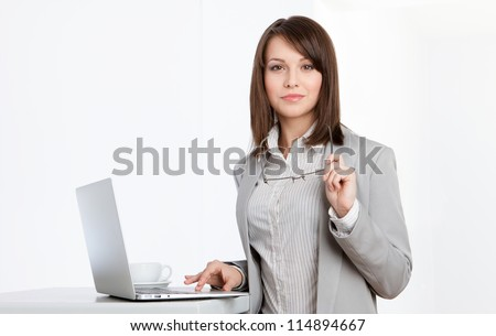 Working on the computer business woman at the office, isolated on white - stock photo