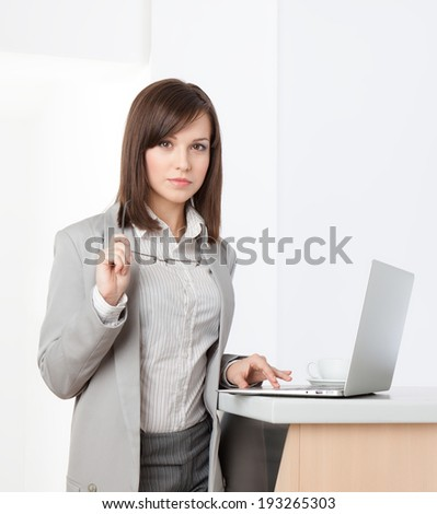 Working on the laptop business woman at the office, isolated on white - stock photo