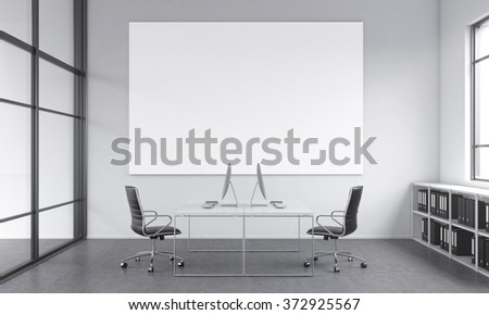 working place for two people, computers and tables opposite each other. A blank poster on the white wall over the tables. Window to the right, shelves under it. Concept of work. 3D rendering - stock photo