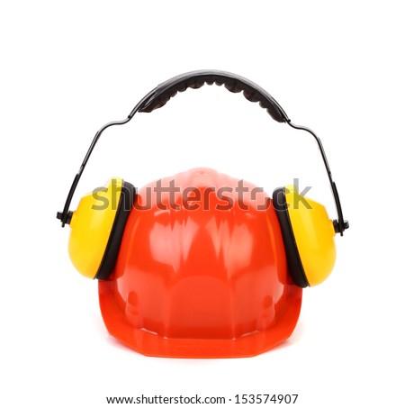 Working protective headphones on hard hat. - stock photo