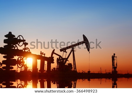 Working pumping unit in oil field  - stock photo