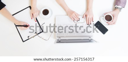 Working table concept. Working on lap top at office desk. Writing in notes. Coffee , smart phone. Late work. - stock photo