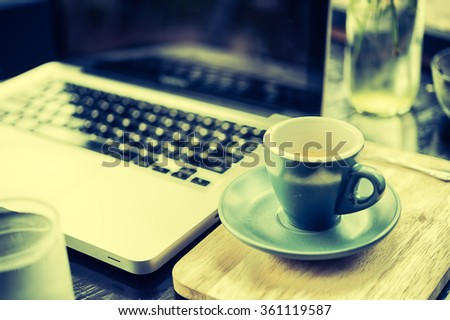working time. hot coffee, espesso with laptop on wood teble. business concept - stock photo