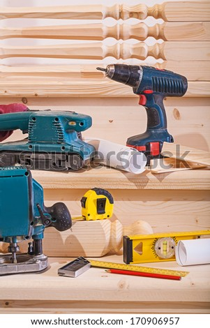 working tools on steps of wooden ladder - stock photo