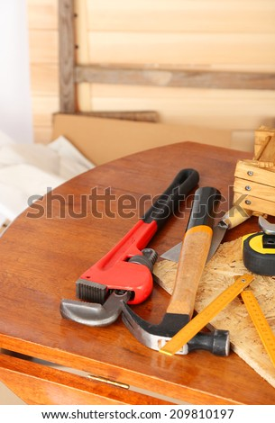 Working tools on table, in workshop - stock photo