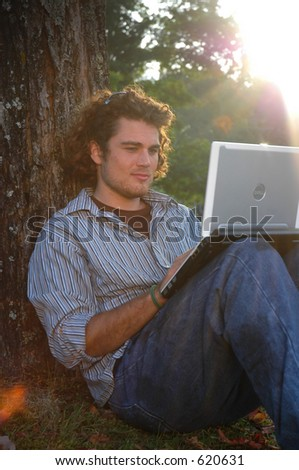 working under a tree - stock photo