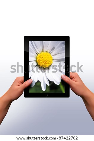 working with a modern flat tablet pc - stock photo