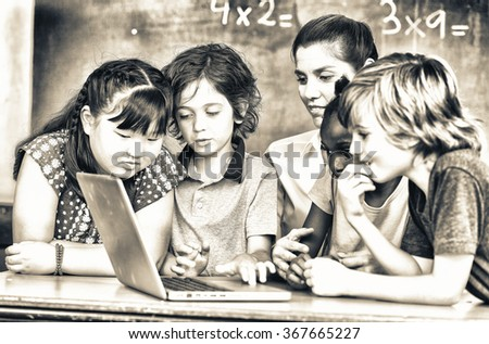 Working with computer together, primary school scene. Success and education concept. - stock photo
