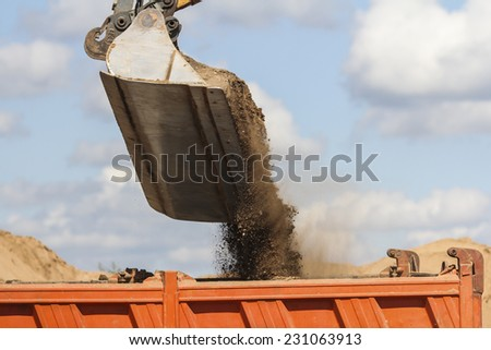 Working with excavator at road construction site - stock photo