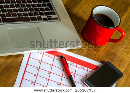 Working with the laptop and organizing monthly activities and appointments in the calendar