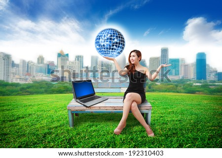 working woman and city background : Elements of this image furnished by NASA - stock photo