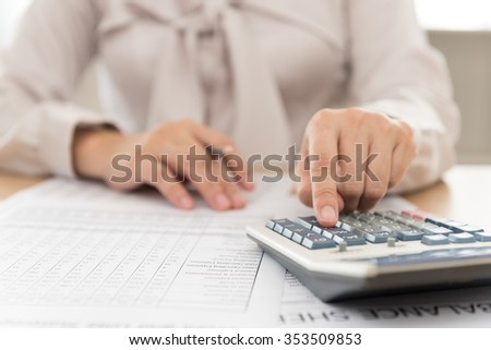 working women checking data from the company's earnings report. selective focus. - stock photo