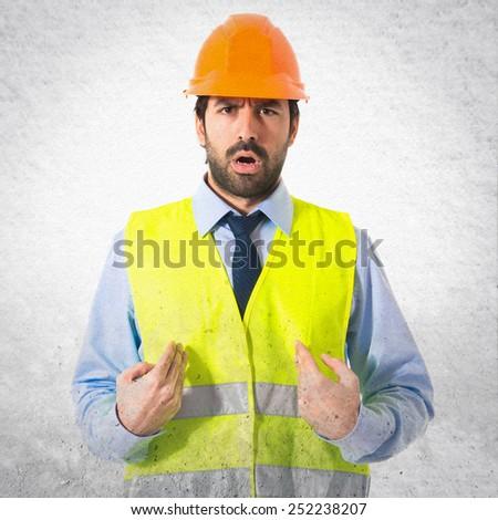 workman doing surprise gesture  - stock photo