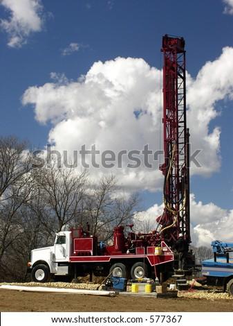 Workman drills water well - stock photo