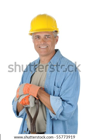 Workman holding onto the handle of his shovel. Man is wearing a hard hat and smiling at the camera. Isolated over white in vertical format. - stock photo