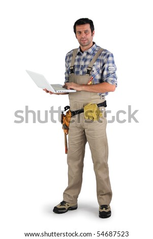 Workman with a laptop computer on white background - stock photo