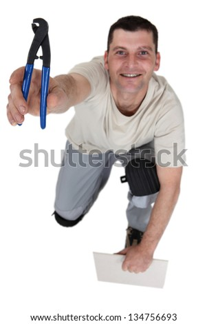 Workman with a pair of pliers - stock photo